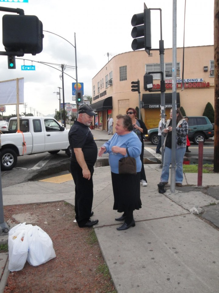 Pastor Nubar Preaching to a Bystander